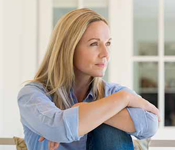 Woman sitting outside the house and thinking about her new idea